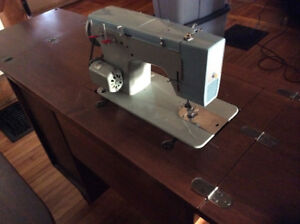 Sewing machine with table