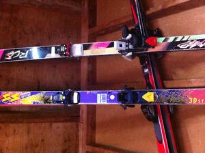 Atomic and Fischer skiis