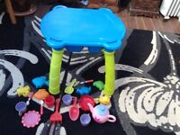 Sand and water tray with toys