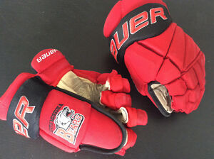 Bauer size 13 Muskoka Gloves. Some palm wear on one glove.