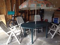 Patio set with table, chairs and umbrella