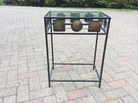 Small metalwork glass top table