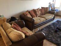 Three piece sofa and snuggle chair