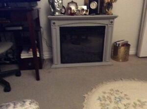 Chesterfield, chair and small fireplace