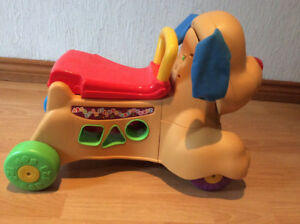 FISHER PRICE- LAUGH/LEARN STRIDE TO RIDE PUPPY