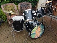 Pearl five piece drum kit with cymbals, black.