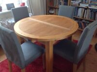 Solid oak table and fabric covered grey chairs