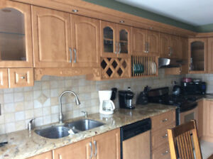 Kitchen upper cabinets in honey oak finish