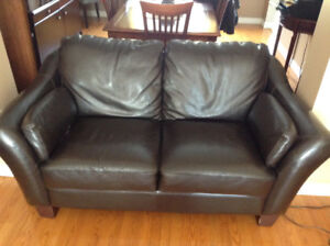 Chocolate-coloured love seat couch