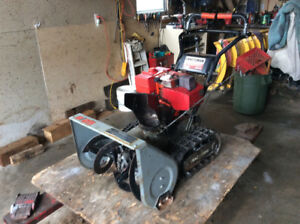 Tracked snow blower