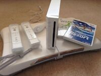 Wii console, Wii Fit board, two controllers with cases and Wii Sports Resort and Wii Fit games