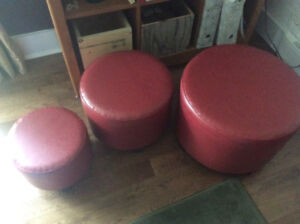 Red leather like stackable stools / footstools.