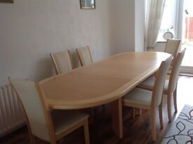 Beech dining table with six chairs