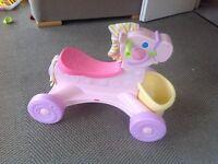 Fisher price ride on pony