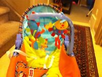 Infant to toddler bouncy/ rocking seat, Activity mat, mobile.
