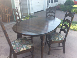 Pine diningroom table and four ladder back chairs $35.00