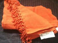 Orange cotton throw