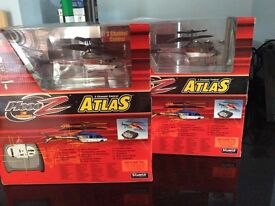 A pair of Silverlit PicooZ Atlas Remote Control Helicopters boxed and unused, ideal gift