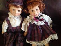 Pair of porcelain boy girl show piece dolls