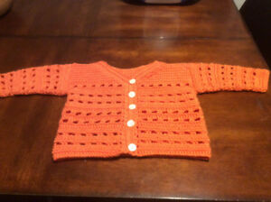 Crochet baby sweater for 6-9 month old.