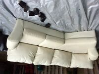 Cream leather 2pc apartment sectional