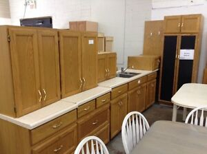 Oak kitchen cabinets with counter at the Waterloo Restore