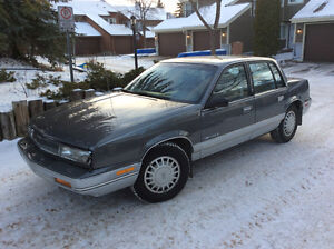 1990 Oldsmobile Cutlass silver Sedan