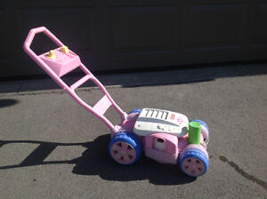 Pink Bubble blowing Lawn Mower