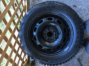 "Studded winter tires 15"" rims included $400 OBO"