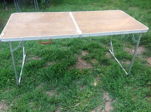 5 ft. long Aluminum light  foulding table - good solid condition