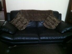 Stylish very soft black leather 2 seater sofa