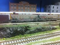Hand painted model train graffiti and weathering
