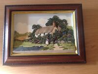 Small embossed countryside scene
