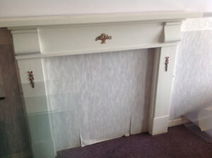 Antique Mantle painted white.  $100.00