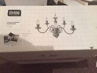 Brand new in box chrome chandelier