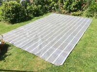 Grey striped awning carpet.