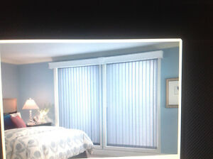 NEW. VERTICAL  BLINDS  -FABRIC OR PLASTIC