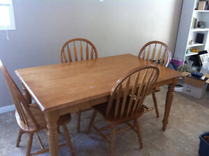 Wooden table and four chair London Ontario image 1
