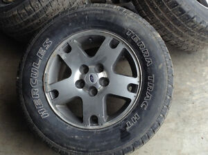 4  Tires and chrome Ford rims