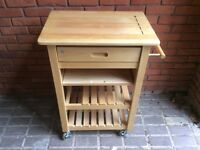 Portable pine kitchen island.