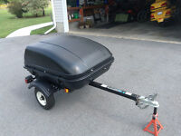 Small car/motorcycle towable cargo trailer.