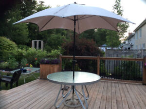"54"" Round Patio table ,sorry the umbrella/stand have been sold"