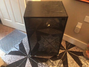 Black electronic multimedia stereo cabinet with glass door