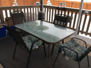 Patio table w/ 4 chairs and cushions