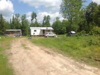100 ACRES WITH WINTERIZED CABIN Owner willing to hold mortgage.