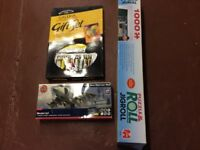 Three craft game items, paint set, airfix model and jigsaw roll cloth