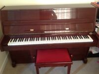 Upright piano with stool for sale in good condition
