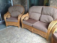 Beautiful wicker/cane/rattan conservatory or patio sofa and arm chairs