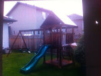 treated kids playhouse and slide swings ect 350 obo