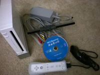 White Nintendo Wii console + remote and nunchuk + wii sport
